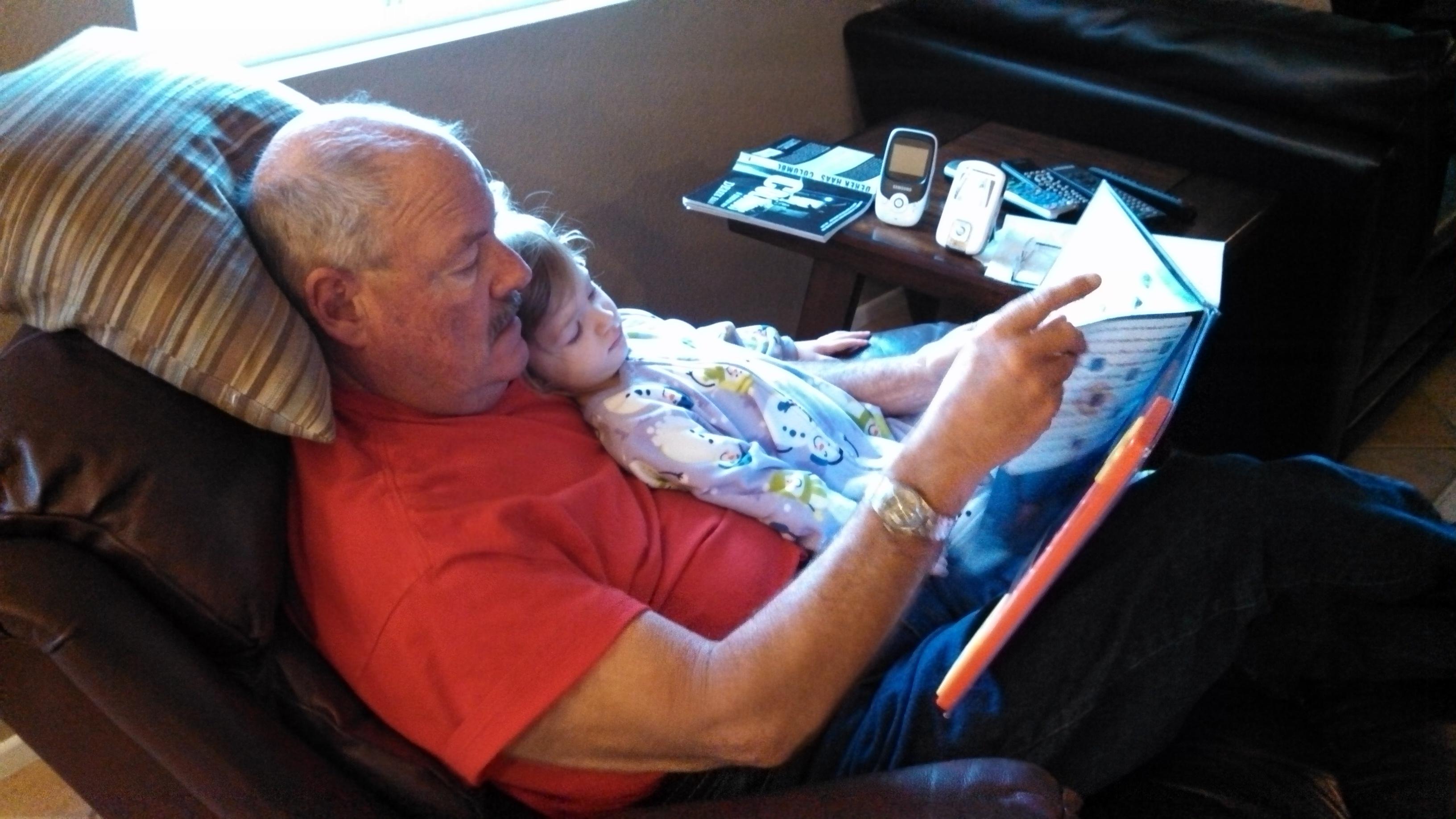 Grandpa reading to Ella